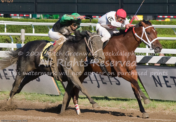"""Tin Cup Chalice (6) has led all the way,  but Thatsrightofficer challenges.  Both horses under """"heavy urging"""". CRW_4687"""