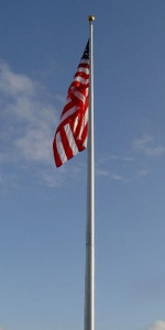 There is a flag standing in a hay field that was erected to honor the memory of two very special WWII veterans. It is located 4 miles north of runway 15 at Bangor International Airport  and is visible to all who fly in or out of the airport. It also serves as a tribute to our active duty personnel and all veterans. When You Fly in or Out of Bangor check out these coordinates: <br /> N44 50 17.46<br /> W068 52 53.38