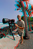3D image of photographer Tom Carey shooting waves breaking at Pahoehoe Beach park, Hawaii