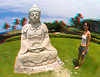 3D image of Lauray standing next to Buddha