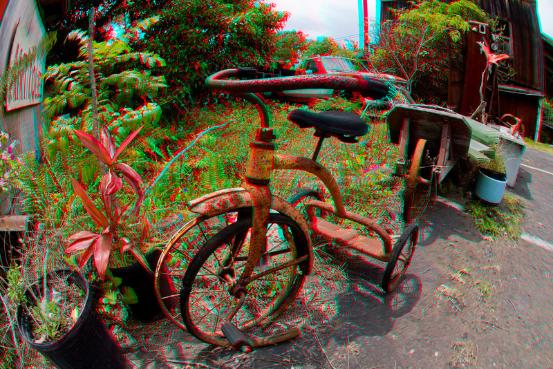 3D image of a tricycle outside an antique shop, Kealakekua, Hawaii.