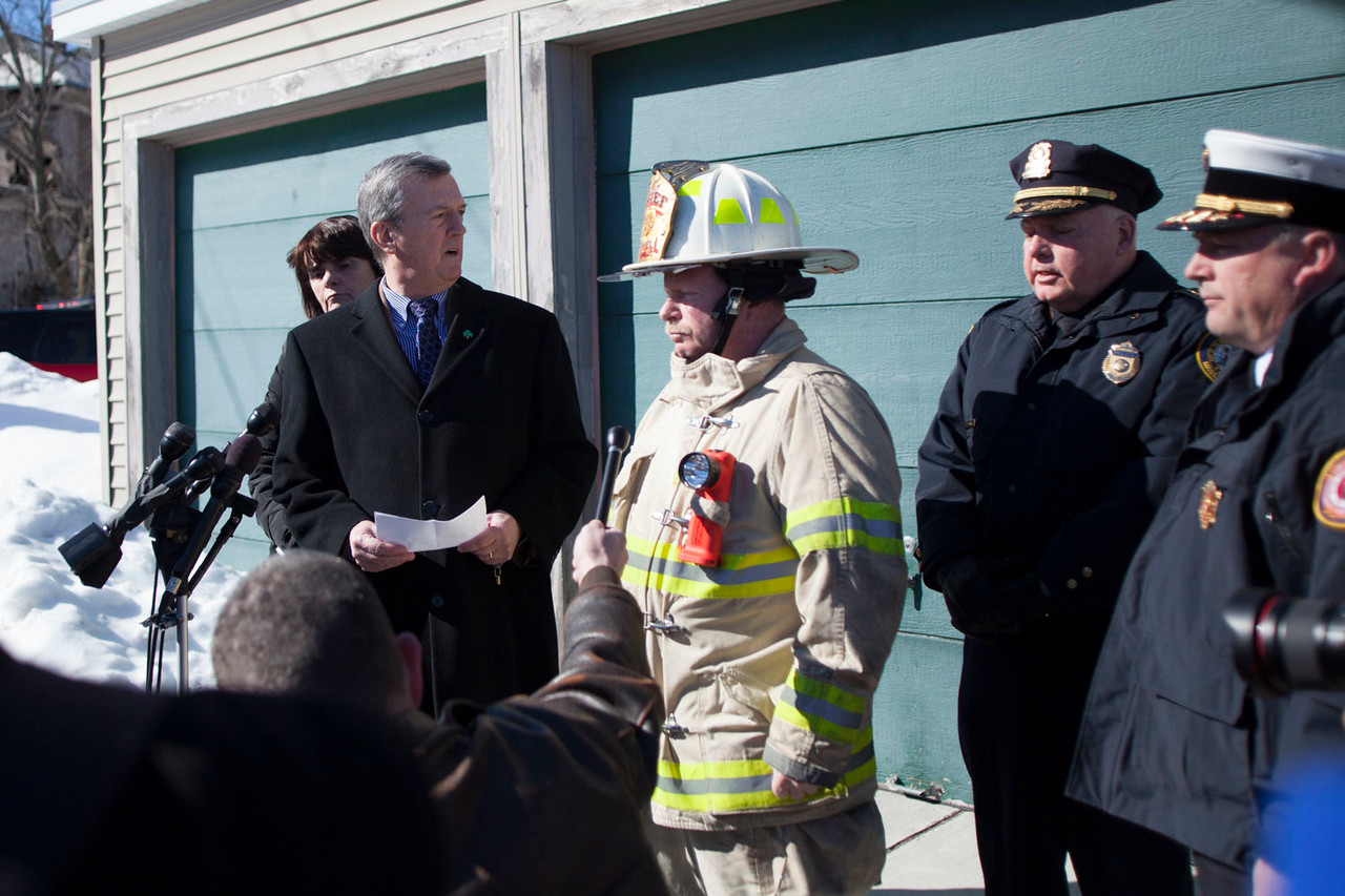 From left to right: Middlesex District Attorney Marian Ryan, Lowell City Manager Kevin Murphy, Lowell Fire Chief Jeff Winward, Lowell Police Superintendent William Taylor and State Fire Marshal Peter Ostroskey stand during a crowded press conference in Lowell about a Parker Street house fire Friday morning. Lowell Sun/Chris Lisinski