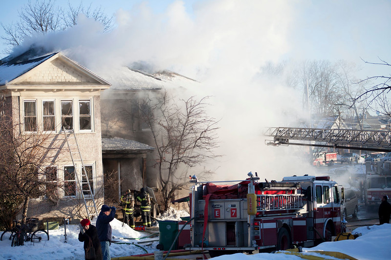 Smoke rises from a fire at 55-59 Parker St. in Lowell on Friday morning. Lowell Sun/Chris Lisinski