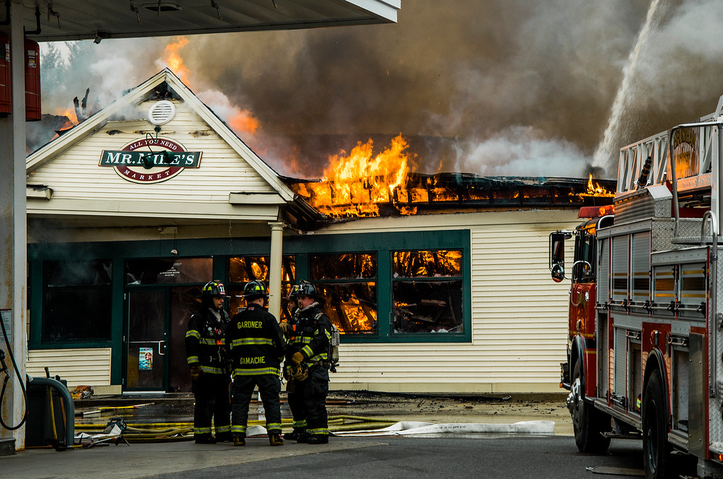 . A three-alarm fire swept through Mr. Mike\'s Mini Mart in Ashburnham on Wednesday afternoon, leaving the structure heavily damaged. Employees of the store reported heavy smoke in the building, located at 6 Gardner Road, at about 3:45 p.m., and quickly evacuated. No one was injured in the blaze. SENTINEL & ENTERPRISE / Ashley Green