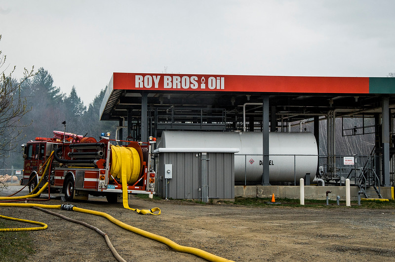 A three-alarm fire swept through Mr. Mike's Mini Mart in Ashburnham on Wednesday afternoon, leaving the structure heavily damaged. Employees of the store reported heavy smoke in the building, located at 6 Gardner Road, at about 3:45 p.m., and quickly evacuated. No one was injured in the blaze. Roy Bros. Oil, located behind Mr. Mike's, was untouched by the flames. SENTINEL & ENTERPRISE / Ashley Green