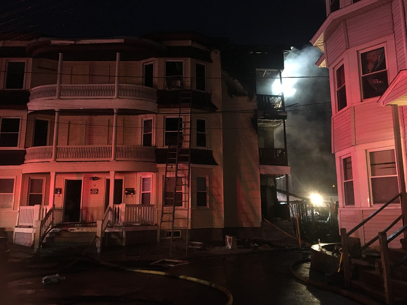 Firefighters were able to contain a blaze at three-story wood frame apartment building at Pleasant Place early Friday morning -- ensuring it did not spread to a nearby complex. No one was injured in the three alarm fire, which heavily damaged 18 Pleasant Place and caused the evacuation of 29 Pleasant Place. SENTINEL & ENTERPRISE / Elizabeth Dobbins