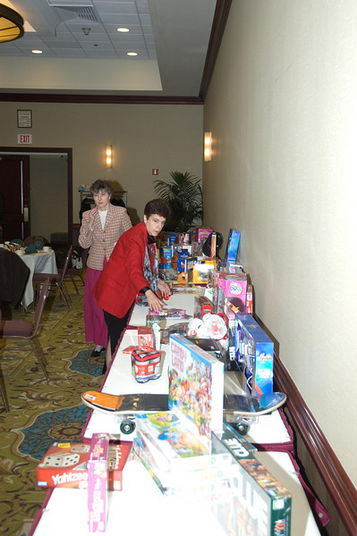 Rita Younker and Sue unload the gifts for presentation.