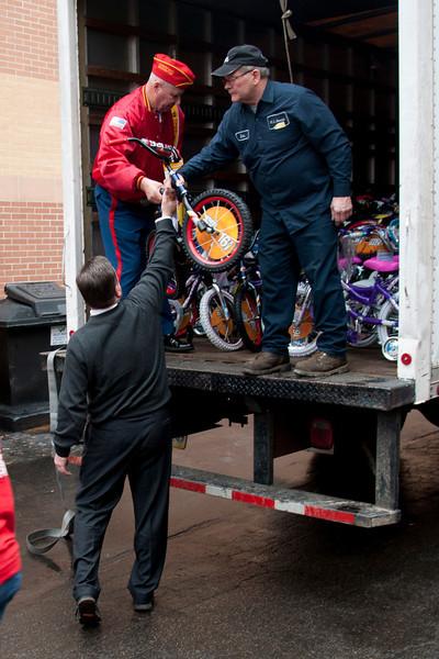 Al Todd loads the last bike on the truck.