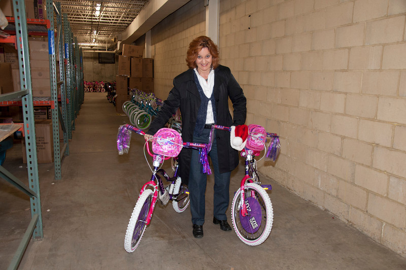 Amy Todd struggles a little moving two bikes.