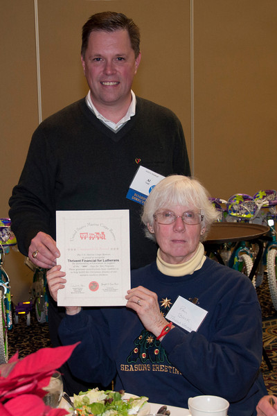 Pam Block, the President of the Allegheny County Chapter of Thrivent, receives recognition for the chapter's work and support of the bike drive.