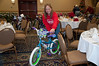 Cora Pucci of the Ambridge Toys for Tots program help organize the bikes.