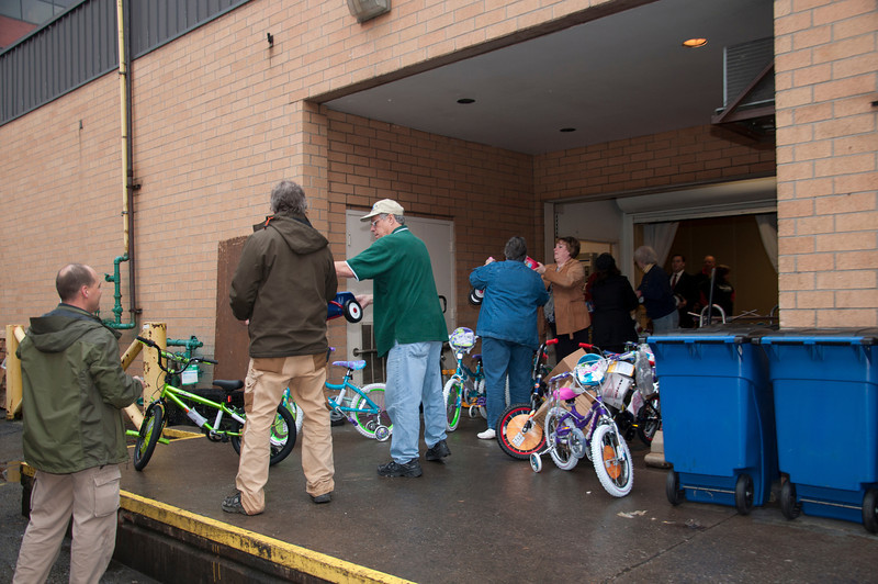 The bikes move from the loading dock to the trucks.