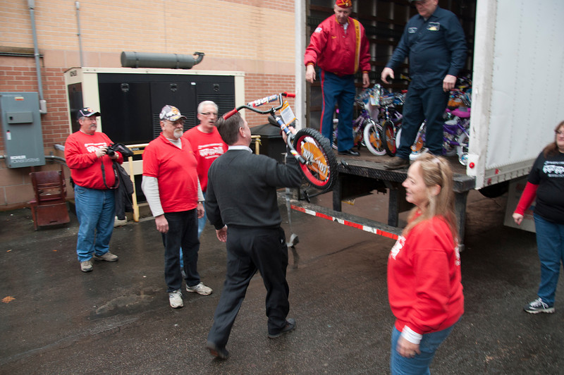 The last bike gets loaded on the truck.