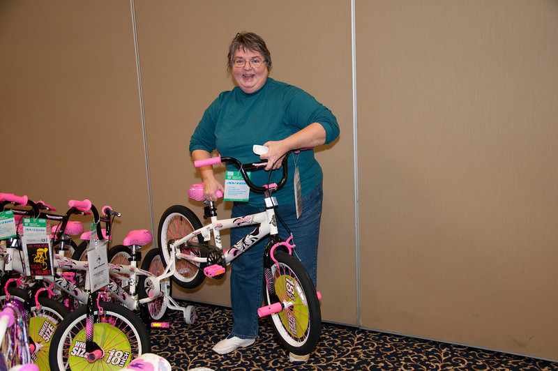 Sylvia Lynn helps line up the bikes.