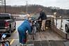 Sylvia Lynn helps Ken Ebbert load his trailer.