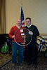 Shane Yoest is recognized with a bronze wheel for his work in soliciting donations for the bike drive.