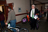 Eric Bowman of the Sheraton assists in bringing bikes inside.