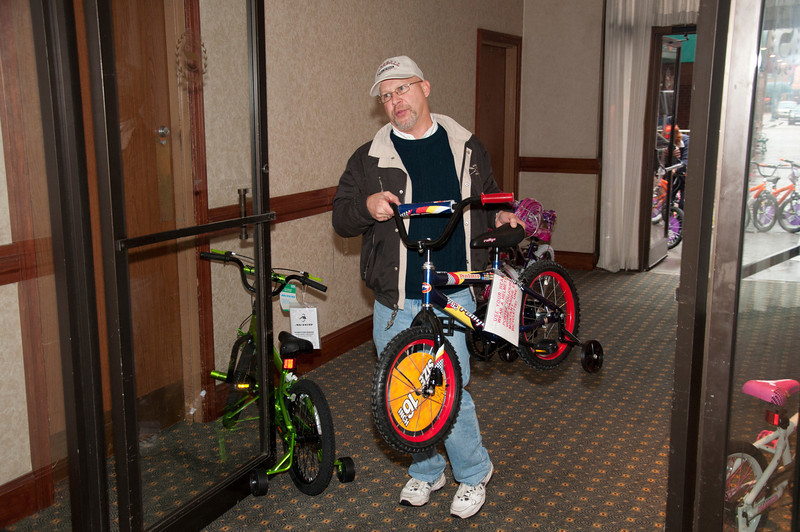 Ron Kims brings a bike into the hotel.