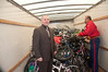 Shane helps Ron Zeiler pack the toys and bicycles.
