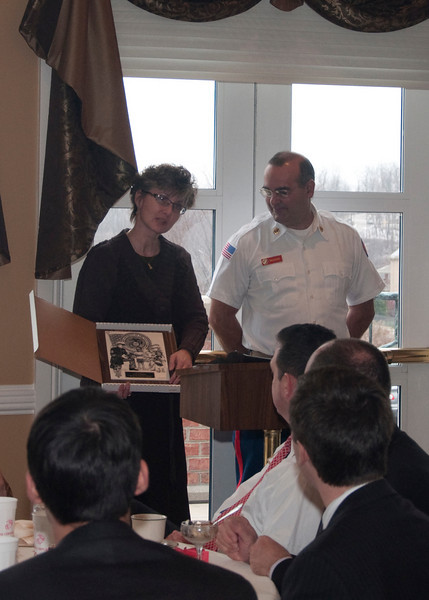 Sue is recognized by the Marines for her years of dedicated service to the Toys for Tots program.