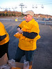 Ron Gredlein unwraps shirts to give to volunteers.