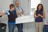 A check was presented by Natalie Ricchutto of Comcast Cable to Allegheny Valley Habitat President of the Board, Carol Harris