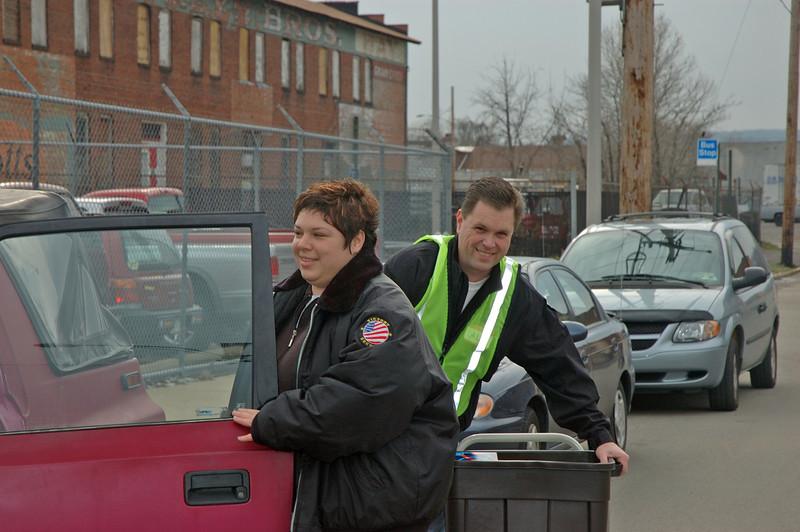 Al Todd helps load a car.