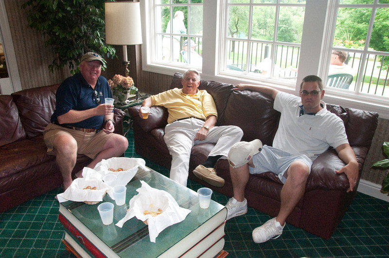 John Utz (center) takes a much needed rest in the clubhouse.