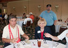 Angelo Cilia offers raffle tickets to volunteer Paula Egnot