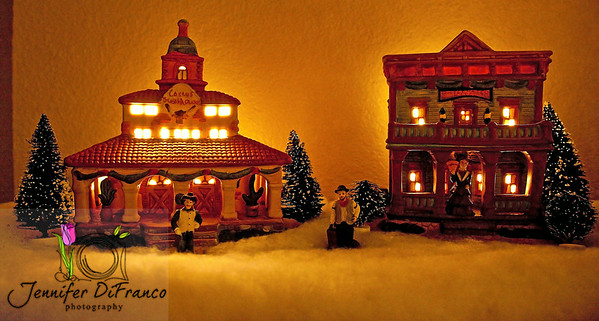 """December 23, 2008  Merry Cowboy Christmas<br /> <br /> This is part of a """"cowboy"""" or western village that sits on the back of our piano.  I love the warm glow that comes from it at night."""