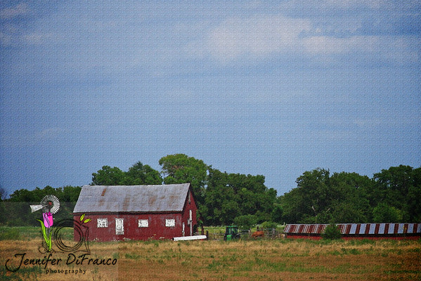 August 14, 2008<br /> <br /> Something about this farm/barn called to me.  Maybe it is because it reminds me of the much slower and simpler times of my childhood.  Texture added in post - was wanting to go for more a painting feel or mood.