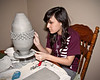 January 15, 2010.  Emily working on her latest art project.  This vase (when finished) will be going in an art competition. Cross your fingers for her please.