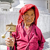 Lady with a Hand Prayer Wheel at The National Memorial  Chorten