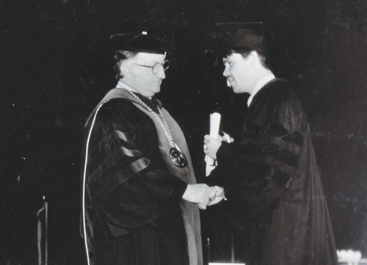 David Ross, DO '82, receiving his diploma from Dr. Pumerantz