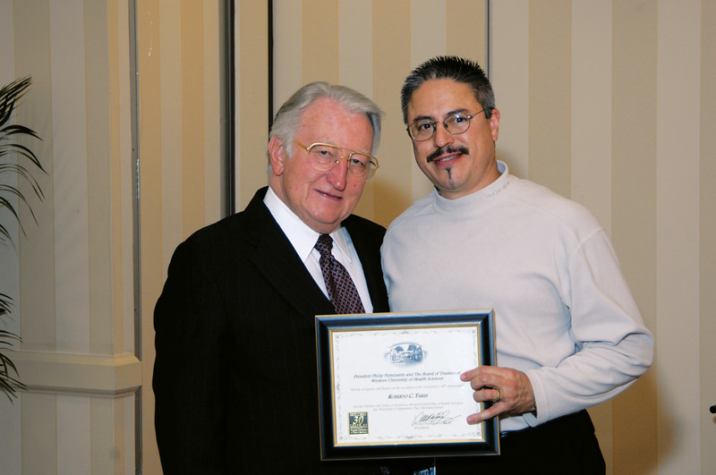 Dr. Pumerantz and Berto Tarin at the employee 20-year anniversary luncheon, 2007