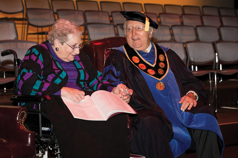 Harriet and Dr. Philip Pumerantz share a moment on stage at Commencement, 2015