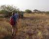 Hiking in a line allows the Samburu trackers a clear shot at any animals that might attack!  Our walking order was always  Guy with a gun, Guy with a Spear, Julian our Safari Guide, Us, Guy with a spear, Guy with a Gun
