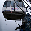 one of many gondolas taking passengers high above the valley floor