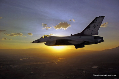 A lone F-16 Fighting Falcon from the U. S. Air Force Thunderbirds flies against the sunrise. The demonstration squadron has recently released its 2009 schedule. (U.S. Air Force photo/Kemberly Dawn Groue)