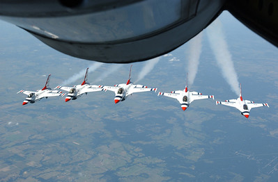 050721-F-7251M-003 	The U.S. Air Force Thunderbirds fly in formation behind a KC-135 Stratotanker before an aerial refueling mission over the U.S. on July 21, 2005.  The Stratotanker from Altus Air Force Base, Okla., linked up with the Thunderbirds' F-16 Fighting Falcons for a refueling mission on their way to Terre Haute, Ind.  DoD photo by Senior Airman Kristi Machado, U.S. Air Force.  (Released)