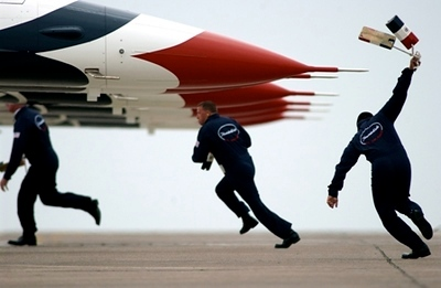 16 April 2005 - Chalks are thrown and Thunderbird crew chief, Staff Sgt. Carey Yamaguchi, races to secure the aircraft upon landing at Laughlin Air Force Base, Texas. United States Air Force Photograph by Tech. Sgt. Justin D. Pyle