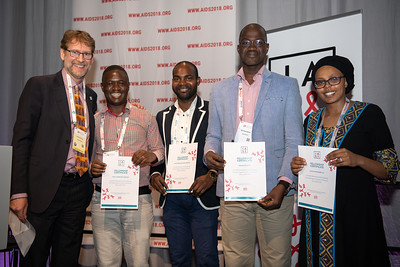 22nd International AIDS Conference (AIDS 2018) Amsterdam, Netherlands.   Copyright: Steve Forrest/Workers' Photos/ IAS  Photo shows: Mark Wainberg Fellowship Programme Award winners. From Left to Right: President-Elect of the IAS, Anton Pozniak; Victor Hamilton Singano; eonid Tome Da Costa Joaquim; Adama Doumbia; Shamim Mohamed Ali, during the IAS Members' Meeting.