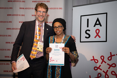 22nd International AIDS Conference (AIDS 2018) Amsterdam, Netherlands.   Copyright: Steve Forrest/Workers' Photos/ IAS  Photo shows: President-Elect of the IAS, Anton Pozniak, with Mark Wainberg Fellowship Programme Award winner Shamim Mohamed Ali, during the IAS Members' Meeting.