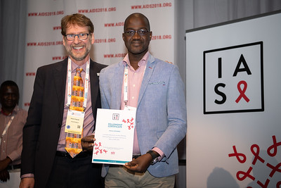 22nd International AIDS Conference (AIDS 2018) Amsterdam, Netherlands.   Copyright: Steve Forrest/Workers' Photos/ IAS  Photo shows: President-Elect of the IAS, Anton Pozniak, with Mark Wainberg Fellowship Programme Award winner Adama Doumbia, during the IAS Members' Meeting.