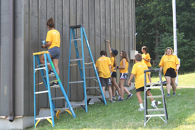 JOHN E. USALIS/STAFF PHOTOMore hands get the job done faster, which was working great for the Crossfire Youth Ministries volunteers on Wednesday as they painted the wooden surfaces of the Ashland Municipal Building/Anthacite Museum as part of the summer project during this week.