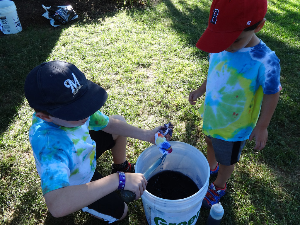 . Brothers who were regular participants in past tie dye events prepared their next masterpiece. Photo by Mary Leach