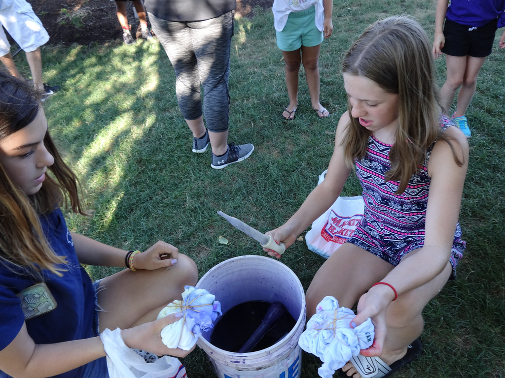 . Girls used rubber bands to squeeze the material of their shirts, which were dipped into the dye. Photo by Mary Leach
