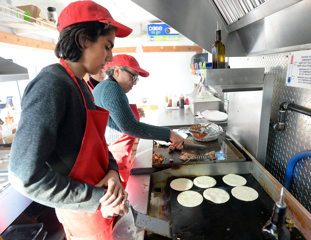 . BOULDER, CO - November 6, 2018: Allan Diaz works with his mother Veronica in the food truck. Tierra Y Fuego taco stand/Diaz Farm in Boulder is being reviewed.  (Photo by Cliff Grassmick/Staff Photographer)
