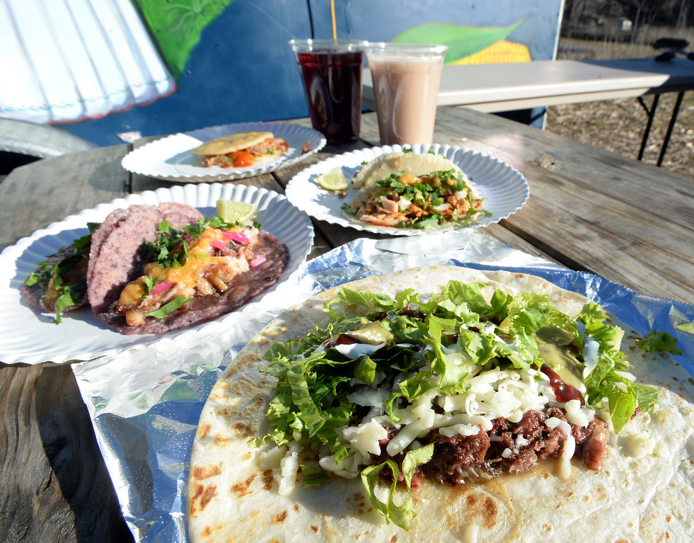 . BOULDER, CO - November 6, 2018: A hibiscus drink, horchata, and carnitas gordita, tacos: pollo adobado, pancita, suadero; barbacoa burrito. Tierra Y Fuego taco stand/Diaz Farm in Boulder is being reviewed.  (Photo by Cliff Grassmick/Staff Photographer)