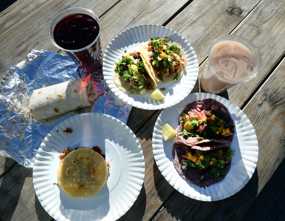 . BOULDER, CO - November 6, 2018:  A hibiscus drink, horchata, and carnitas gordita, tacos: pollo adobado, pancita, suadero; barbacoa burrito.Tierra Y Fuego taco stand/Diaz Farm in Boulder is being reviewed.  (Photo by Cliff Grassmick/Staff Photographer)